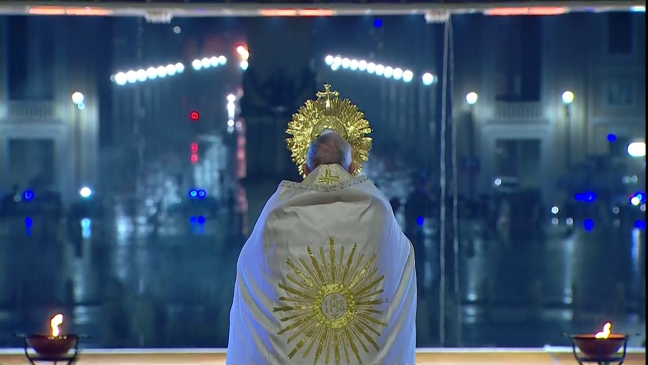 Pope Francis elevates the Blessed Sacrament in an empty St. Peter's Square.